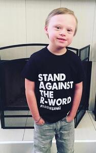 Cam wearing a Stand Against the R-Word t-shirt